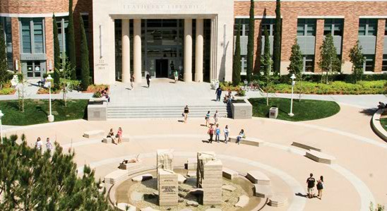 Aerial view of the piazza and front of Leatherby library with students milling about.
