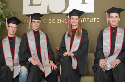 Group of Chapman University ESI students in graduation gowns and caps