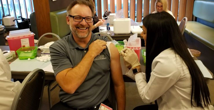 Jeff Goad, professor and chair of the Department of Pharmacy Practice at Chapman University's School of Pharmacy receives a flu shot.