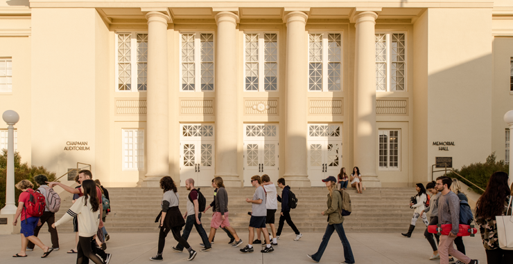 picture of a building at chapman university with students walking past