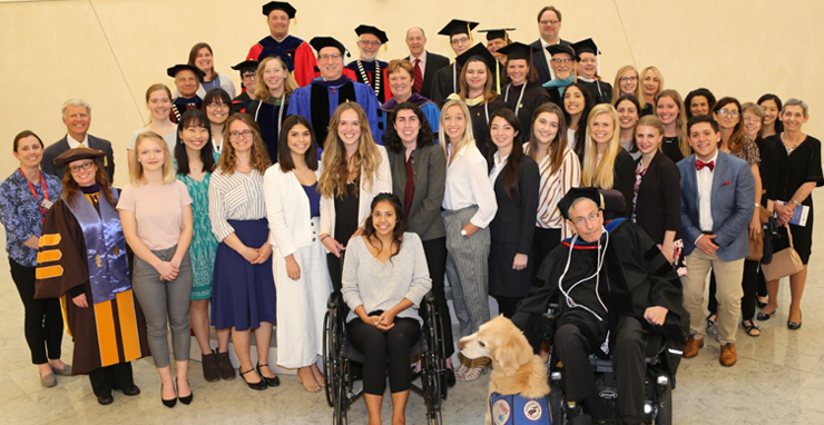 picture of a group of students and professors and a dog