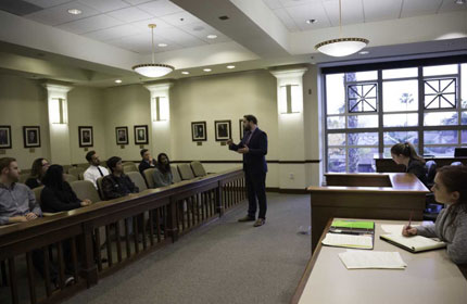 Chapman law student in a mock courtroom