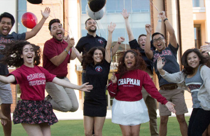 Chapman Phi Beta Kappa Students cheering together outside with balloons