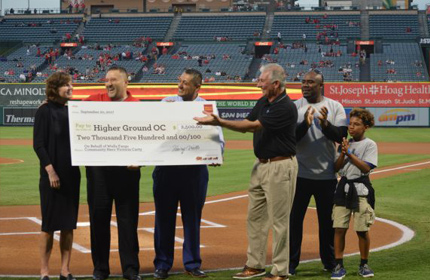 Victoria Carty receiving award check at Angel's Stadium