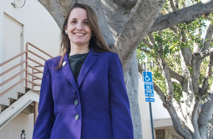 Chapman Law Professor Wendy Seiden posing on Chapman campus outside