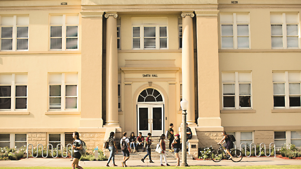 Students walking past building