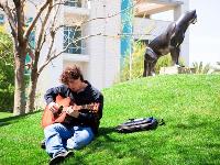 Man playing guitar on lawn