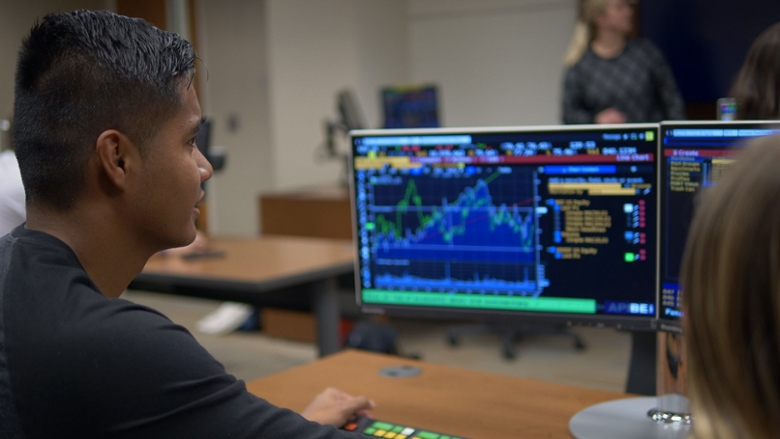 Chapman student working on a Bloomberg Terminal