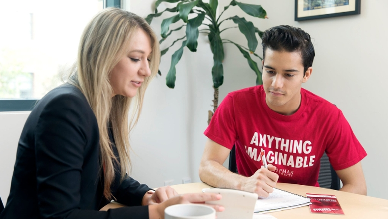 A financial aid counselor meeting with a Chapman University student