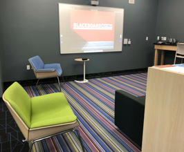 Colorful chairs and projector from Tech Hub