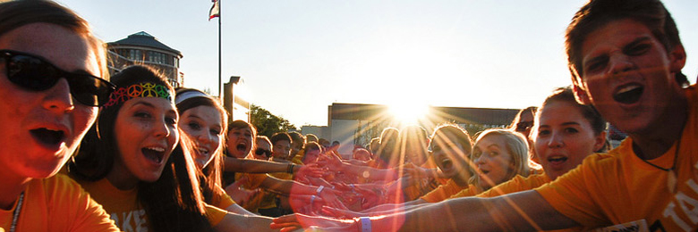 Chapman orientation leaders welcoming new students at sunset