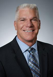 headshot photo of Dr. Mark Brouker