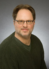 headshot photo of Dr. Brian Glaser