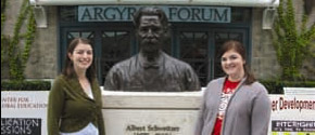 Students pose with a bust of Albert Schweitzer