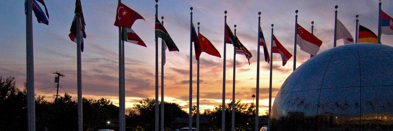 The flags at the Global Citizens plaza at sunset