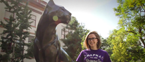 Student named Katherine smiling next to Pete the Panther Statue